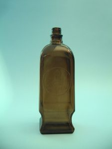 Brown medicine bottle made of sugar glass. Height 26 cm x diameter ø 8.5 cm. 4 angular, 26 cm x ø 8.5 cm.