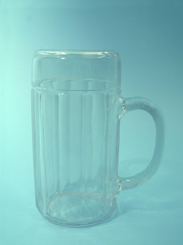 Sugar glass beer mug. 1 L serrated motif HxW 20.7 cm x 11 cm.