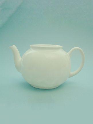 Sugar glass teapot. Dimensions teapot approx. 12 cm. x 16 cm.